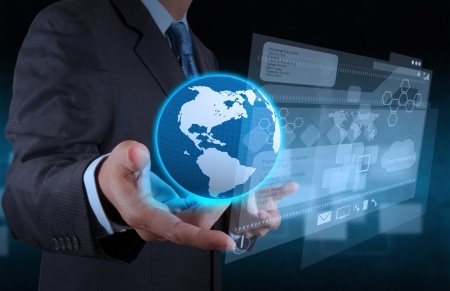 abstract_cyber_globe_with_businesspersons_hand